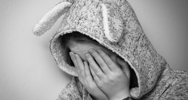 Kid with rabbit hoodie crying
