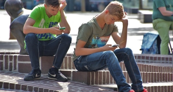 Teens playing Pokemon Go